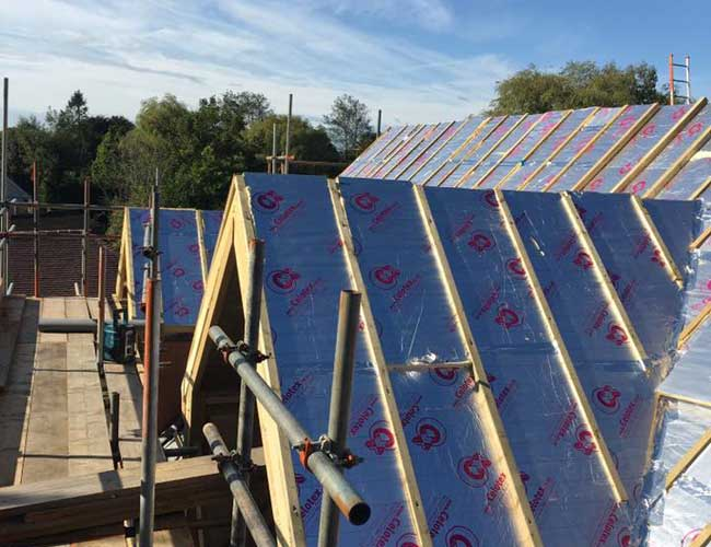 Roof repair showing insulation ready for tiles